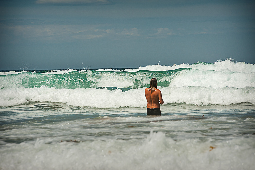 A Sydney swimmer watches the waves increase in size and frequency, a portent of the unseen storm thundering in the distance.