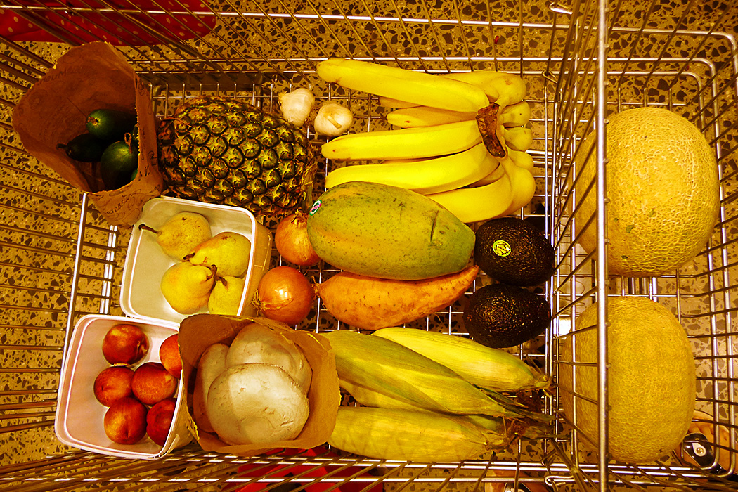 Loose fresh produce in shopping trolley.