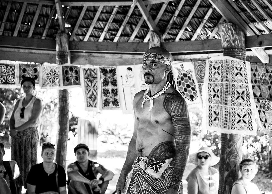A handsome, tattooed Samoan man explains his tattoos are a symbol of dedication and a rite of passage.