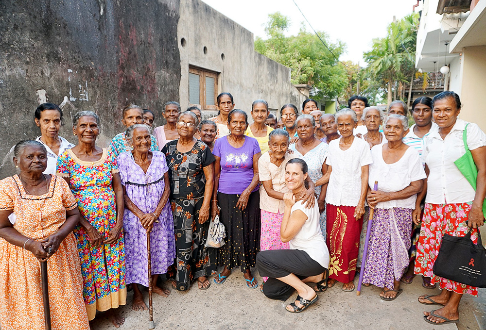 Anita Horan with elderly women in Sri Lanka.